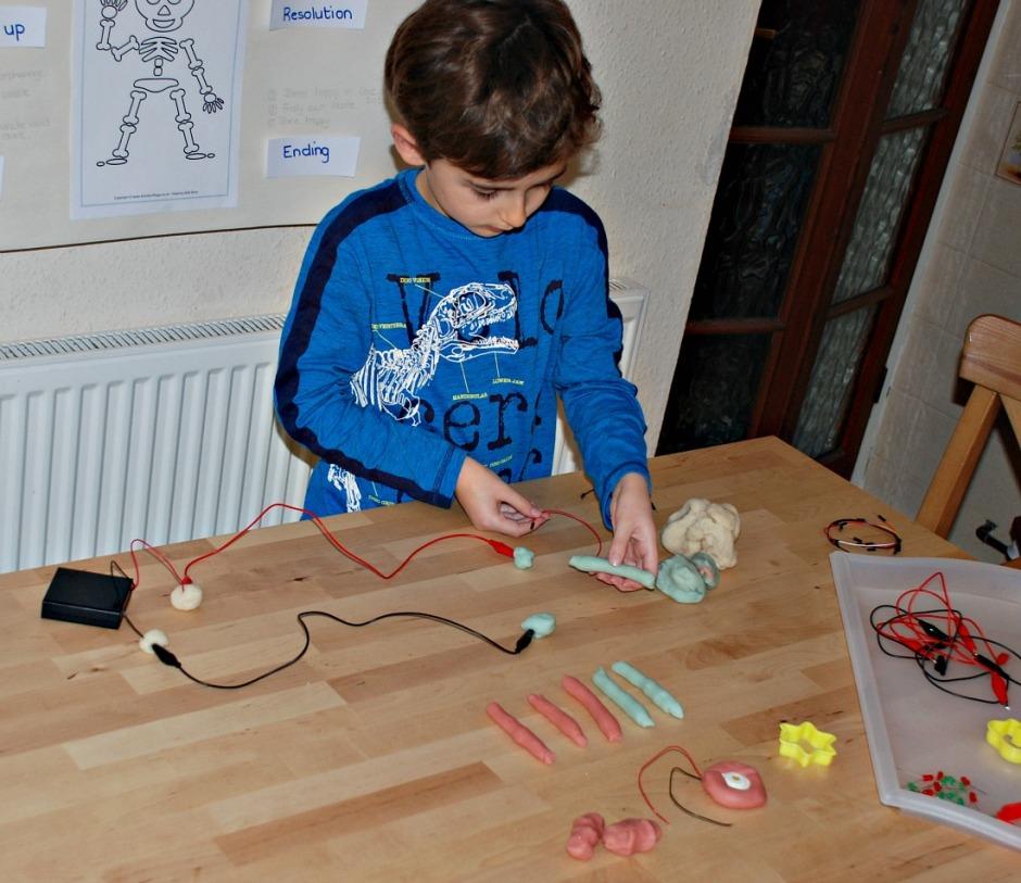 Creating circuits with his DIY Electro Dough Kit