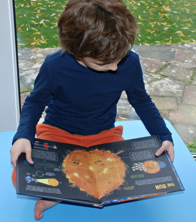 reading his Discover Our Solar System book by Colin Stuart