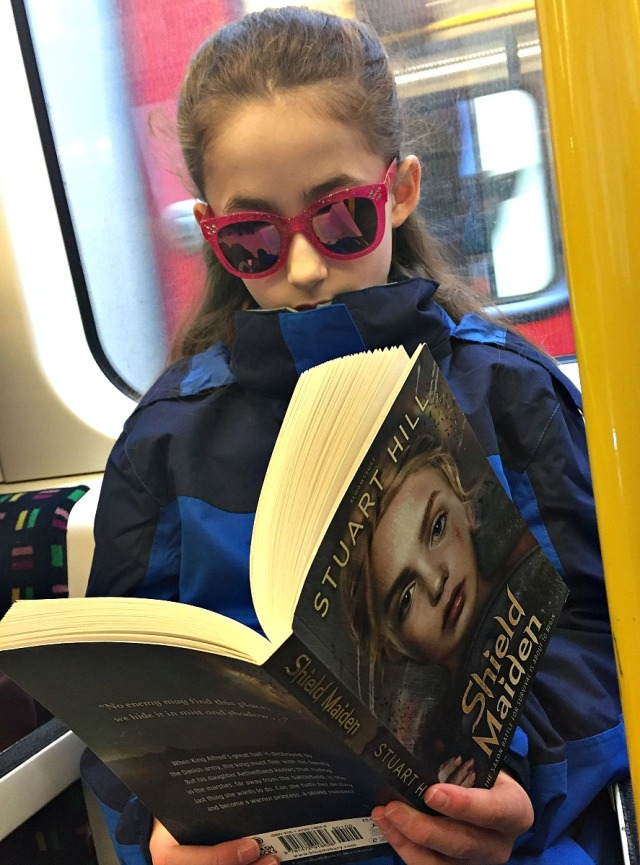 reading her Anglo-Saxon story. Shield Maiden on the train