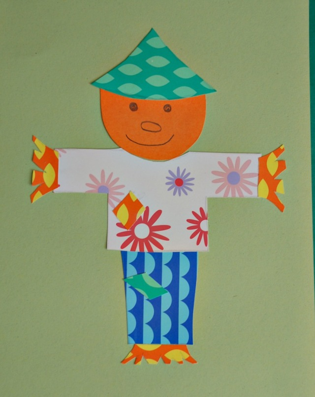 colourful paper collage. a colourful fun scarecrow