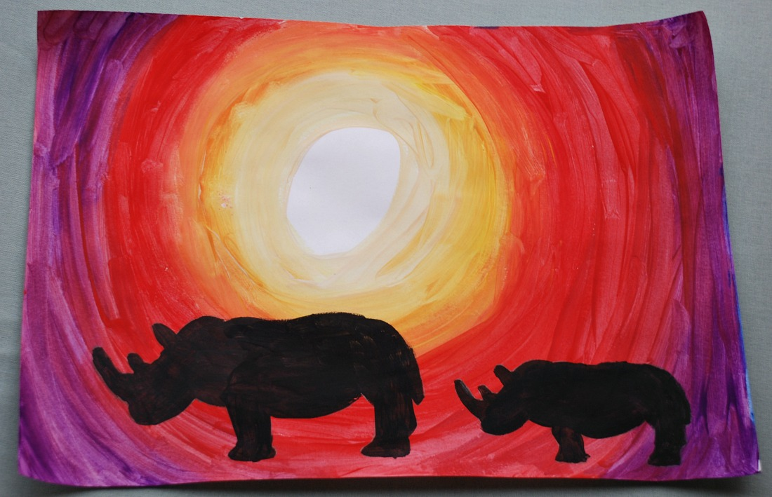 Rhino under the African sun.  A silhouette painting created by kids